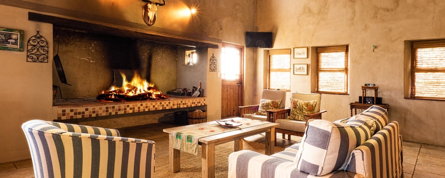 fireplace in beach cottage accommodation at Boggomsbaai near Mossel Bay
